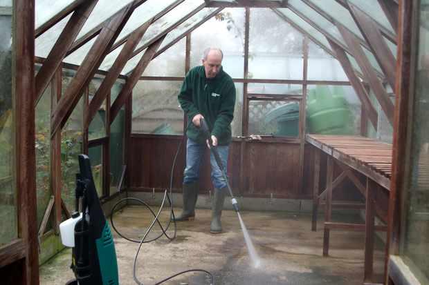 pressure-washing-the-greenhouse-2