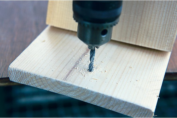 Drilling a hole into the back panel
