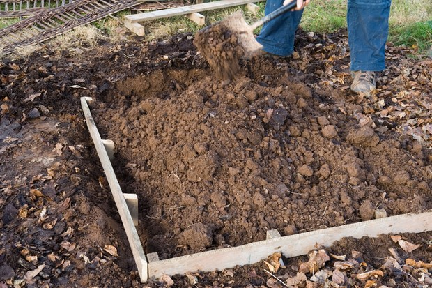 How to make a strawberry bed - timber placed in trench