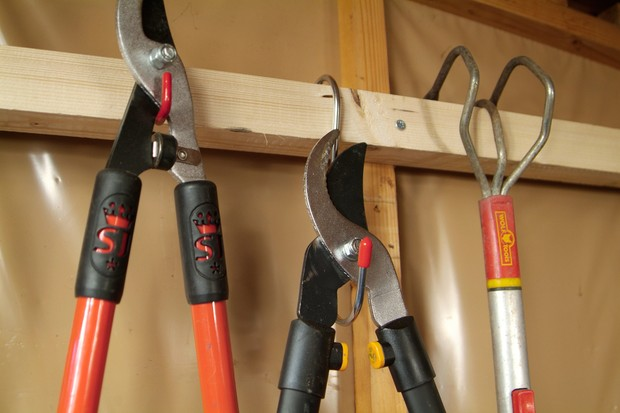 How to clean and repair your garden shed - tools on a rack