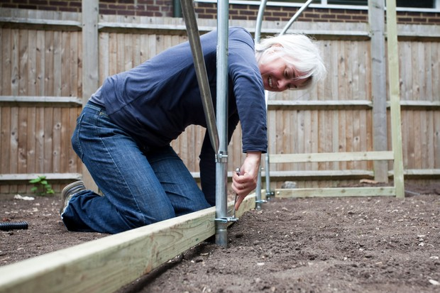 How to build a polytunnel - bolting in the foundation tubes