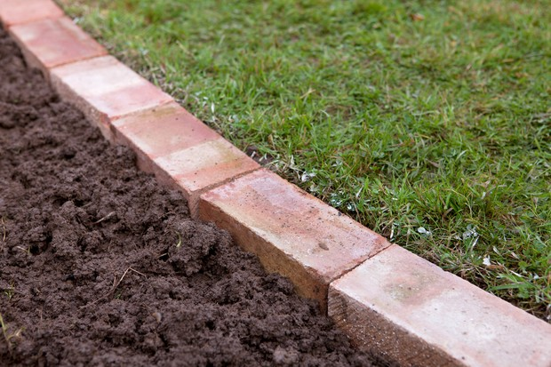 edge a lawn with bricks project