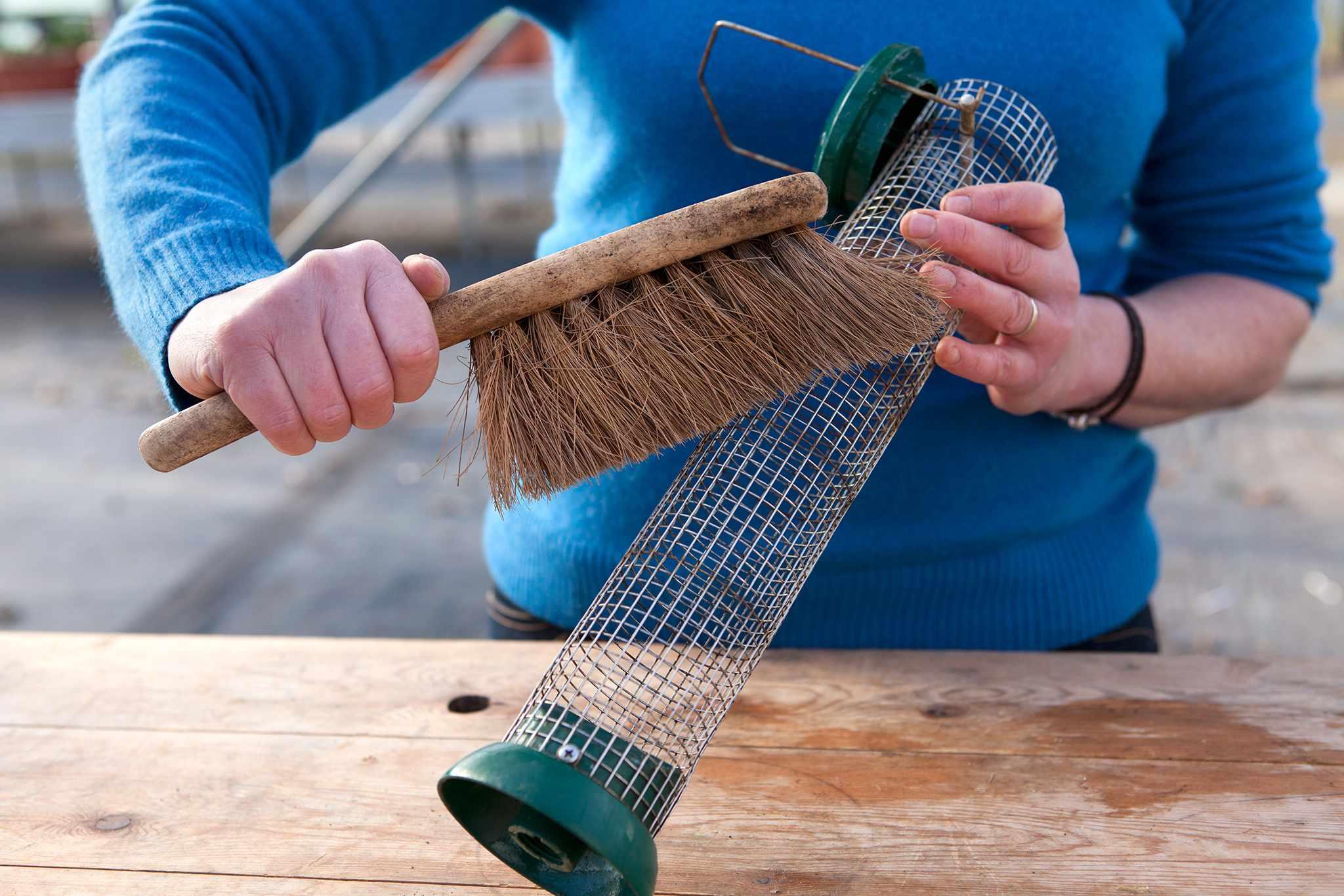 Cleaning a bird feeder