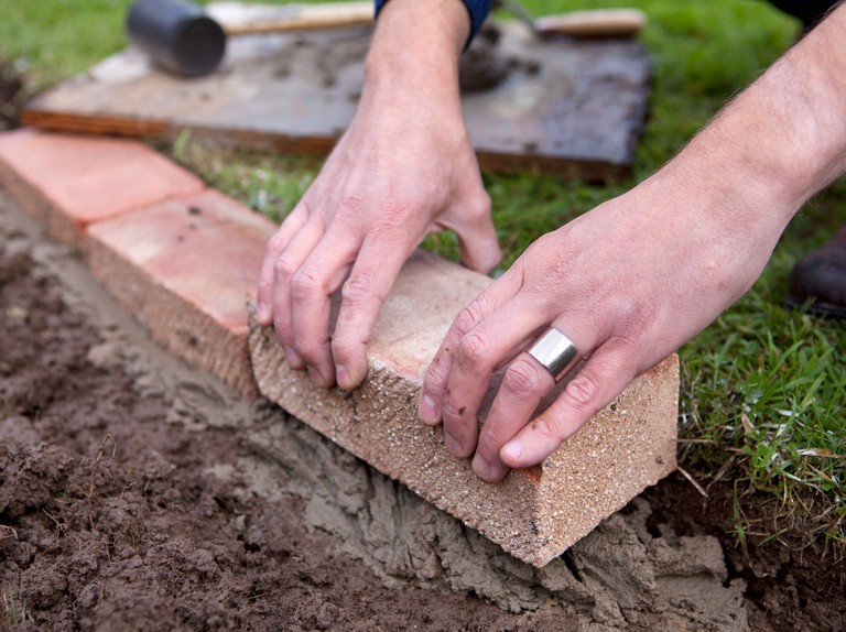 How To Edge A Lawn With Bricks Bbc Gardeners World Magazine