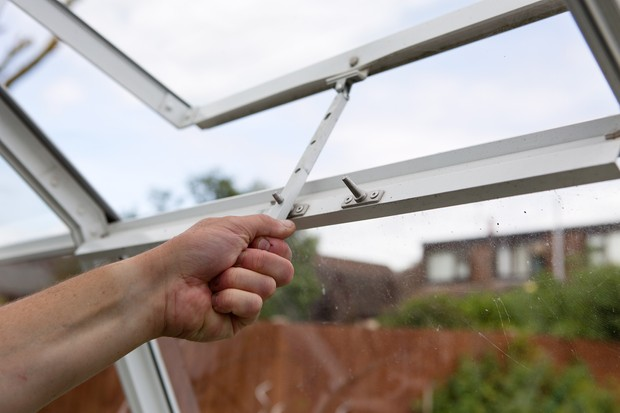 Opening a greenhouse window