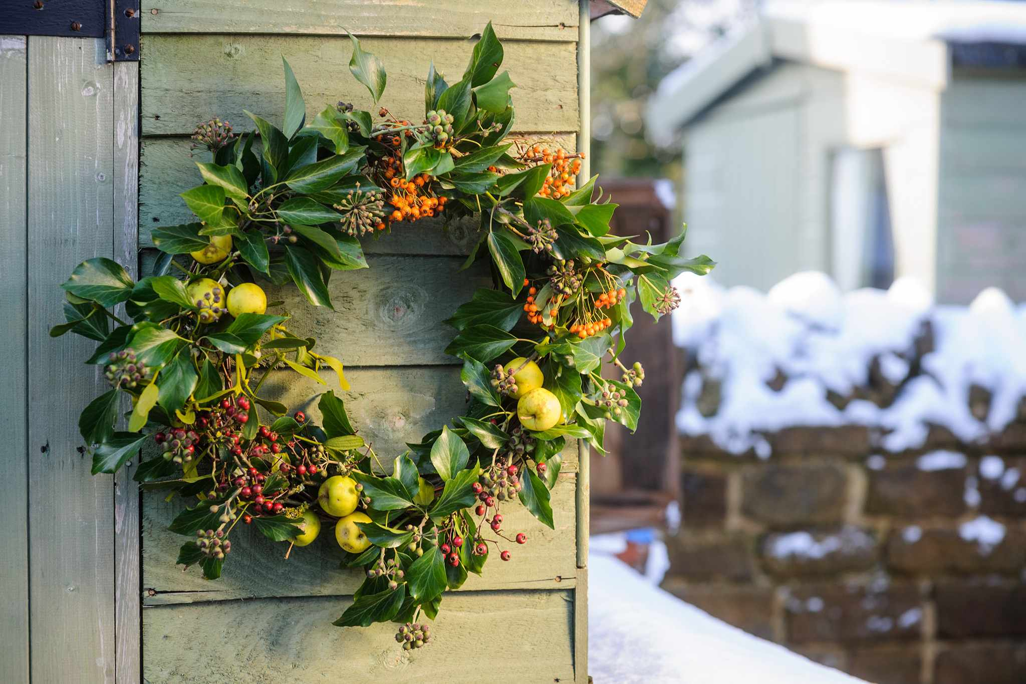 Pyracantha, ivy and crab apple Christmas wreath