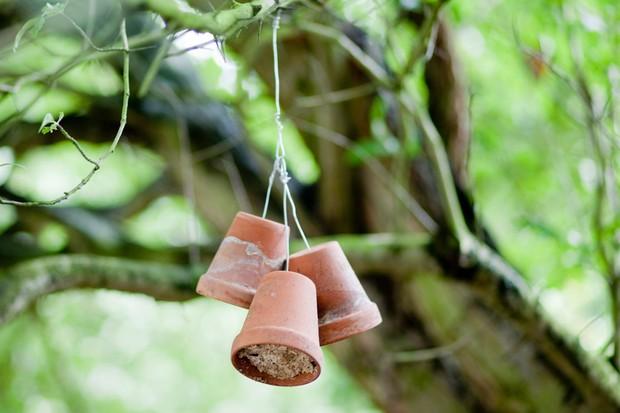 A home-made terracotta pot bird feeder