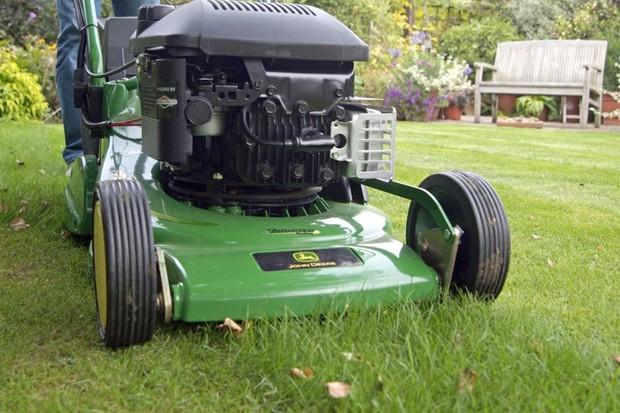 Mowing a lawn on a fine day