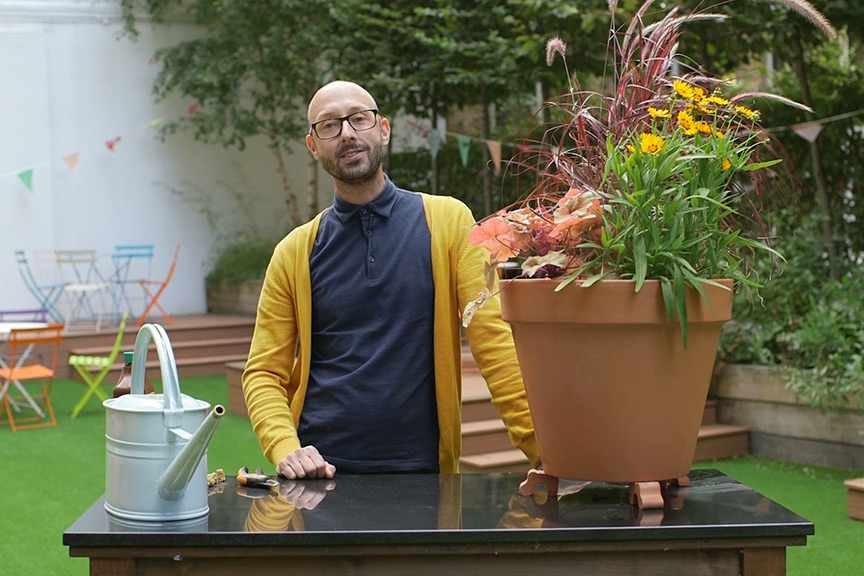 Feeding and watering plants in pots video