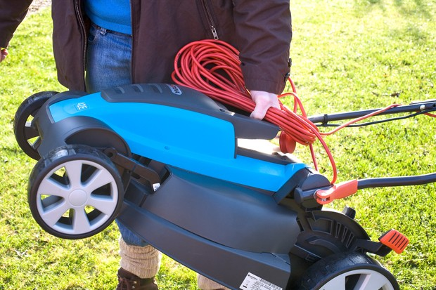 Carrying a corded electric mower