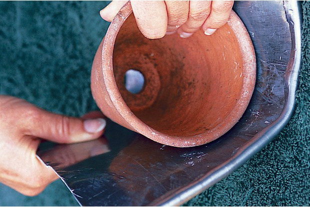 Making a lead planter - wrapping the lead round a pot