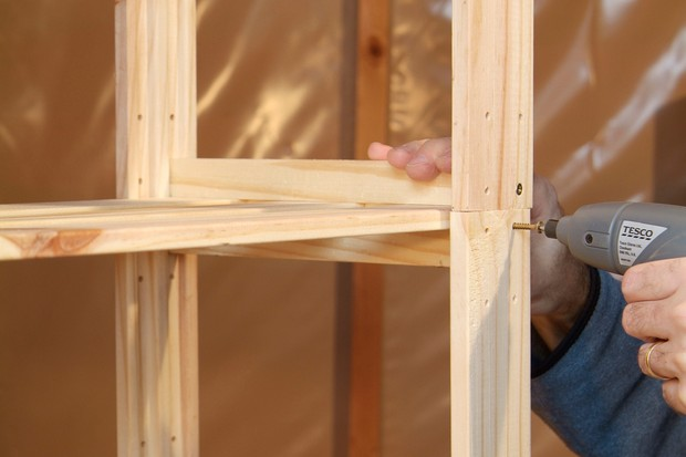 How to clean and repair your garden shed - fixing a shelving unit together