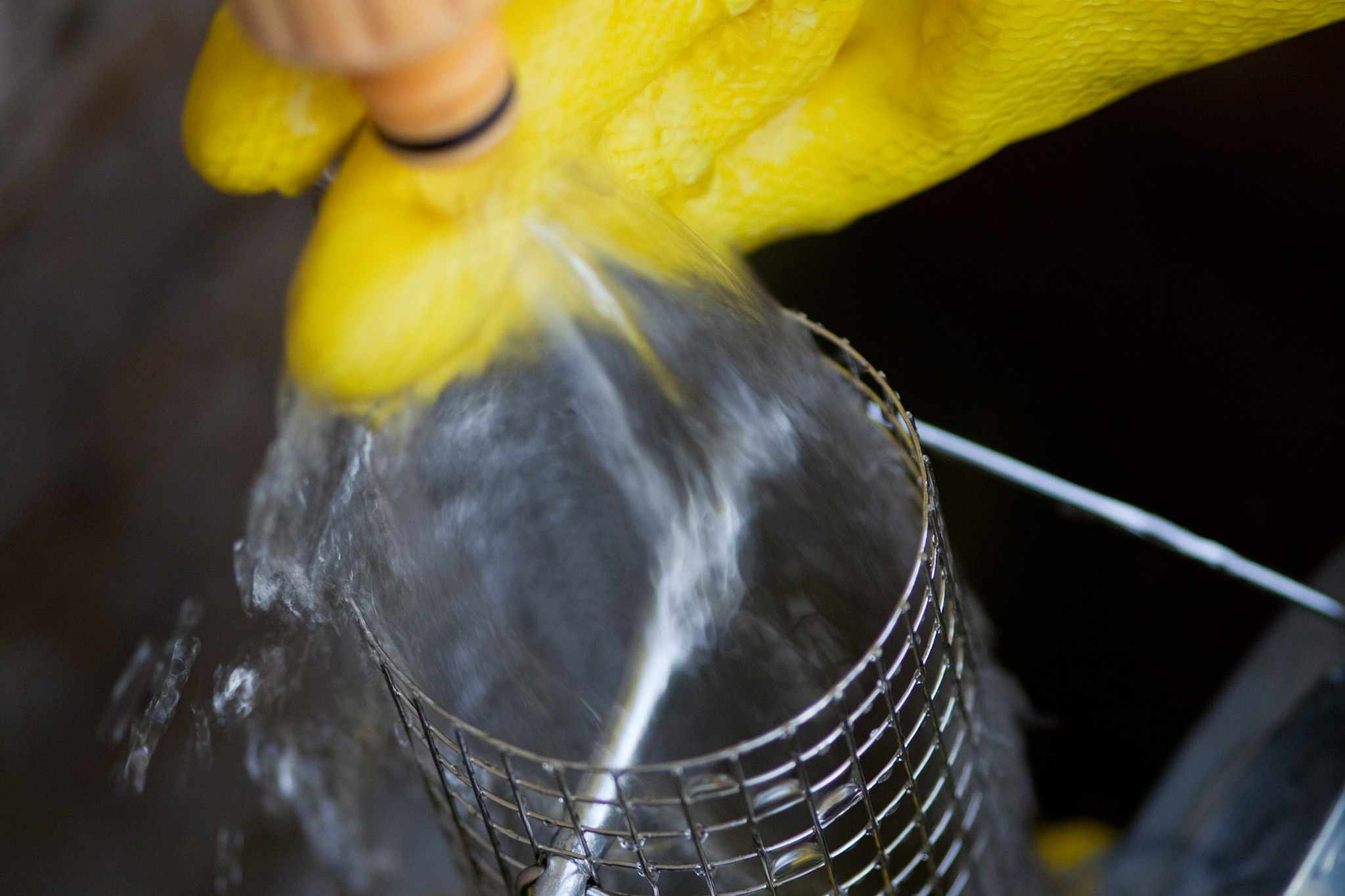 Washing a wire bird feeder