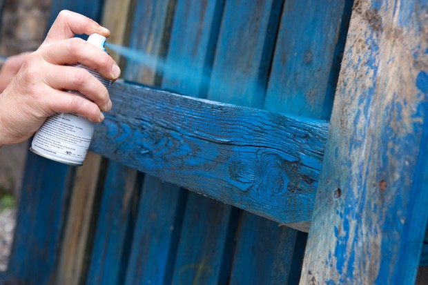 painting-wood-preservative-on-a-fence-2