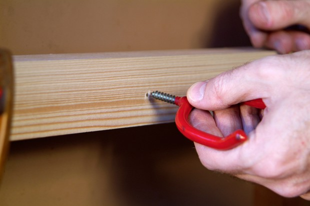 How to make a garden shed tool rack - screwing in the hooks