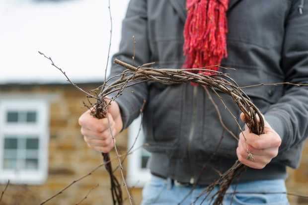 Tying the birch twigs to create a circle