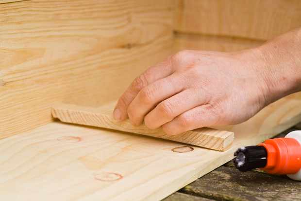 sticking-wooden-strips-to-the-side-of-the-box