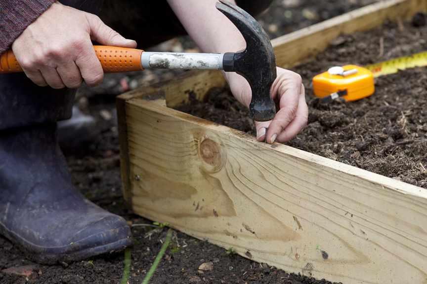 Do I treat wood for raised beds
