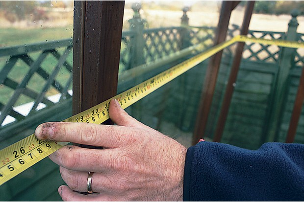 Measuring the sides of the greenhouse