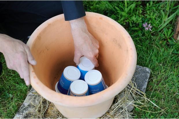 Adding crocks to the bottom of the pot