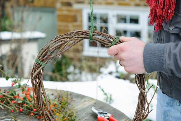 attaching-string-for-hanging-a-christmas-wreath-2