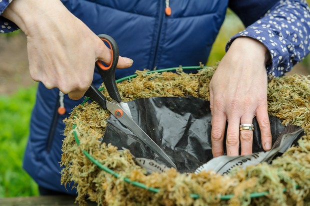 Adding plastic to the basket to aid water retention