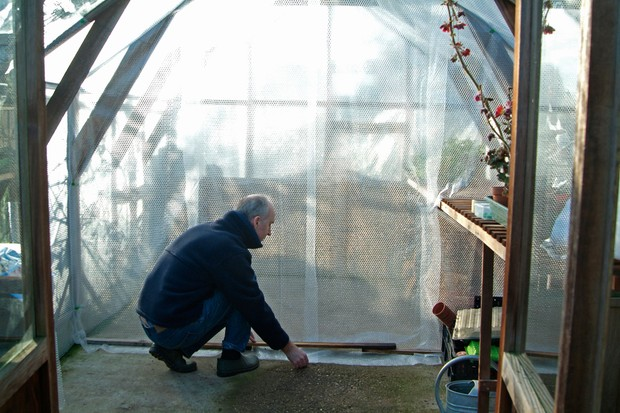 Creating a bubble-wrap curtain to divide a greenhouse