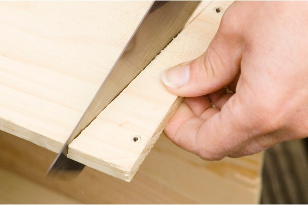 sawing-the-side-of-the-box