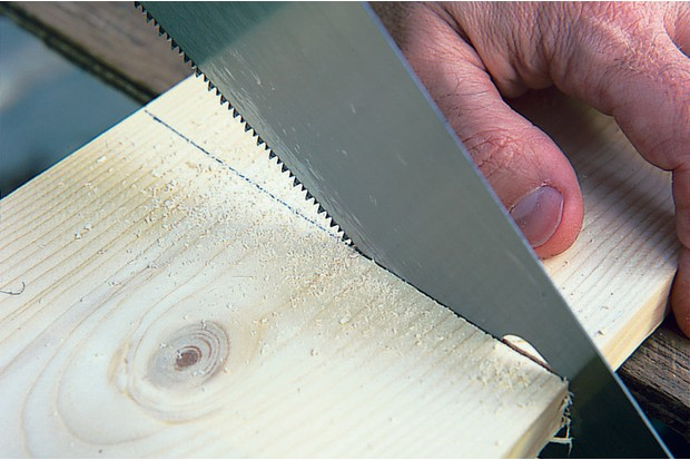 cutting-wood-with-saw-2