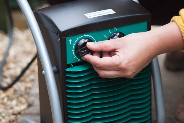turning-on-an-electric-heater-in-a-greenhouse-2