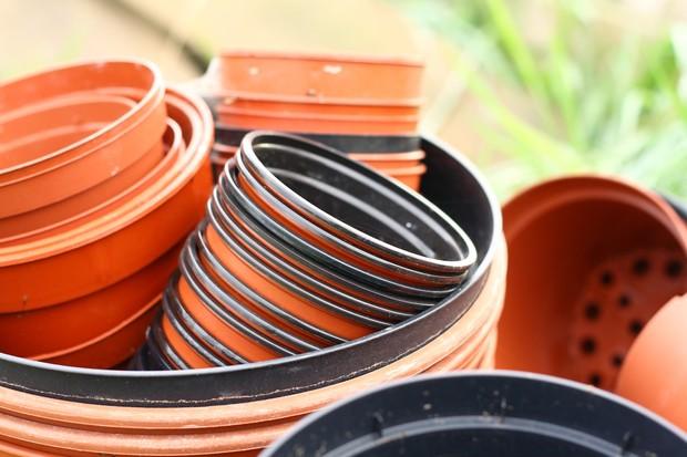 PIle of plastic plant pots