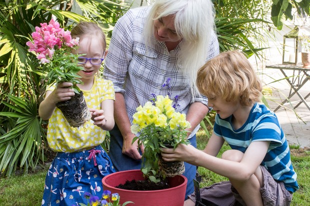 Children planting summer containers