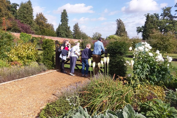 bowood-adam-with-guests-garden-2048-1365