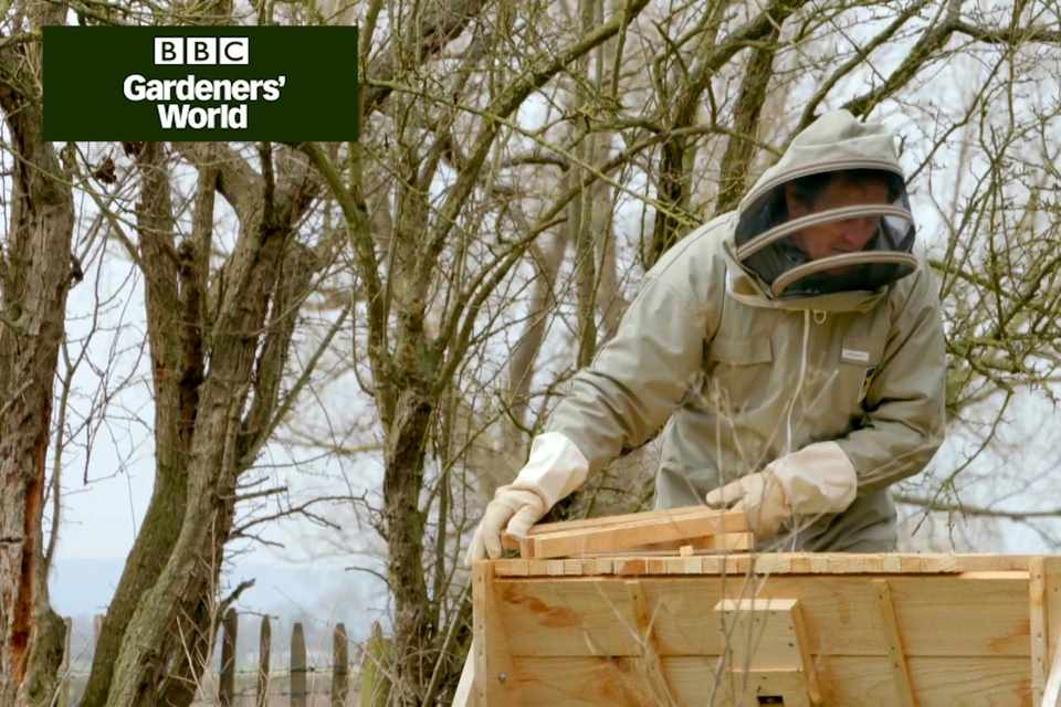 Monty Don inspecting a beehive