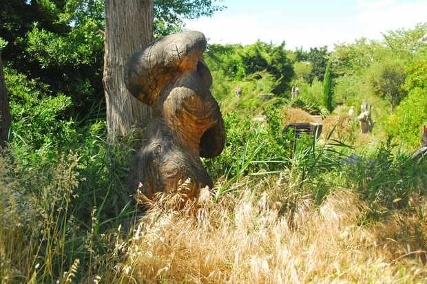 Wooden sculpture in artist Marc Nucera's garden