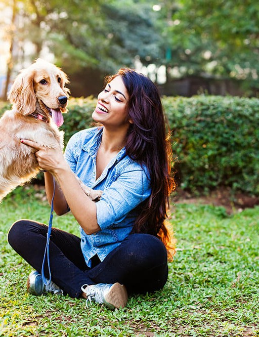 Pet dog with a woman outdoors
