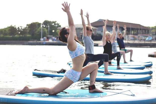 Paddleboard yoga with Charlene Lim of Trika Yoga