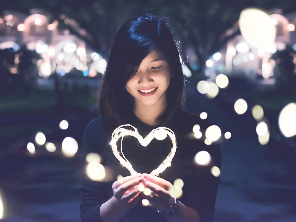 Smiling woman with heart