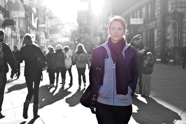 Urban girl standing out from the crowd at a city street.; Shutterstock ID 126318380; Purchase Order : -