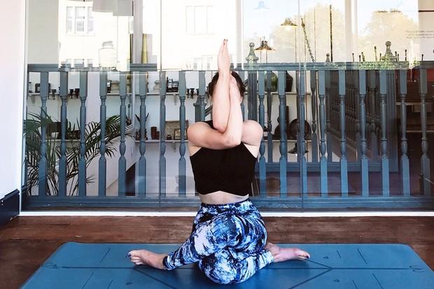 Kate Bennett doing yoga