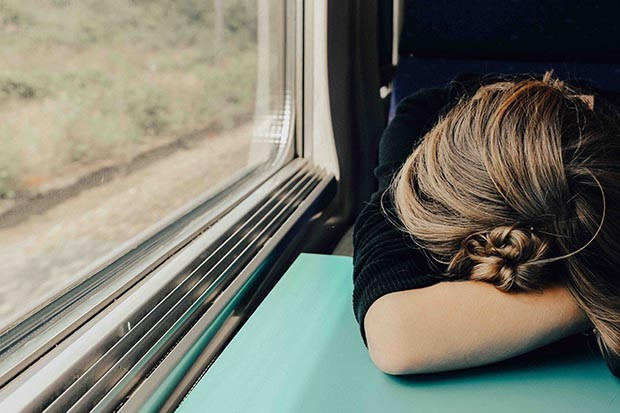 Stressed woman on a train