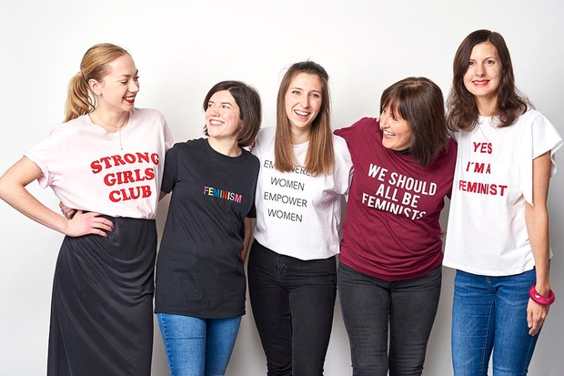 The In The Moment team wearing feminist slogans