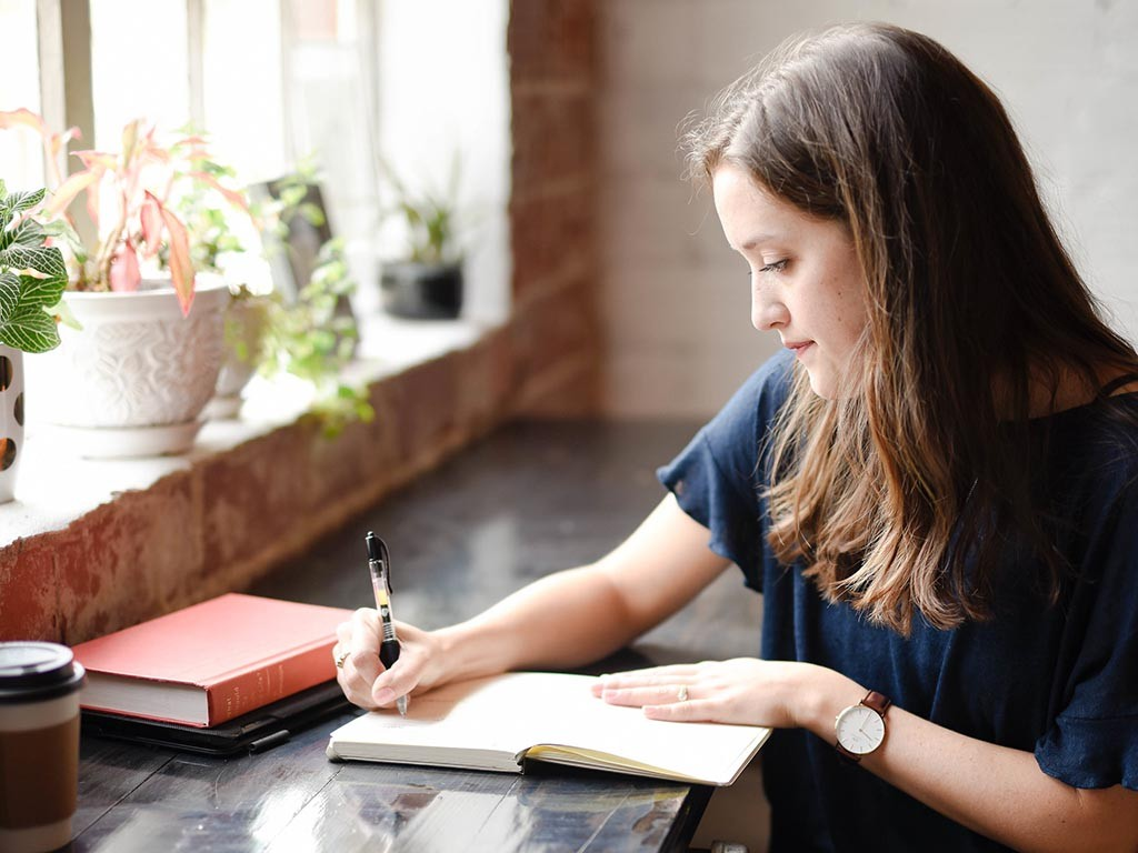 Woman writing in a notebook