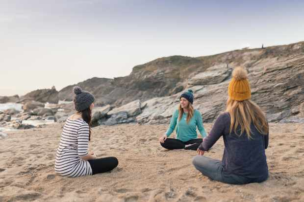 Joanna Hulin meditating on the beach