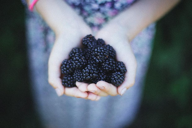 Woman holding blackberries