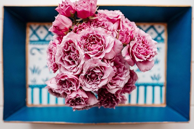 Roses on a blue tray