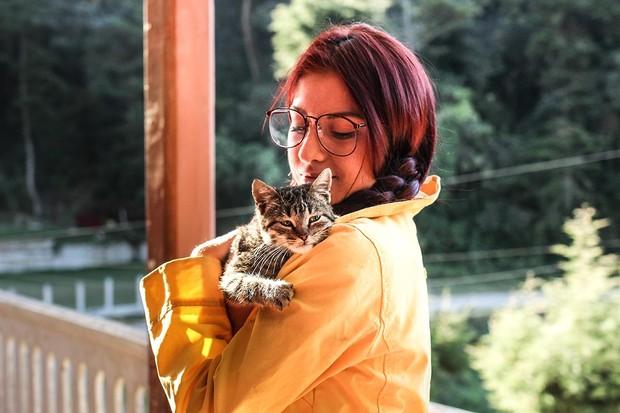 Cat loves owner Mel Elias