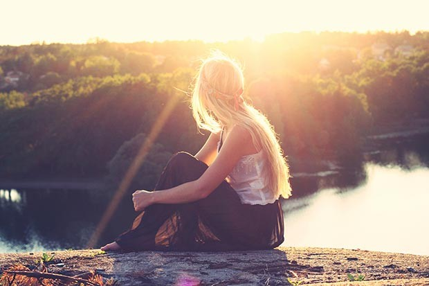 Woman sitting in the sunshine