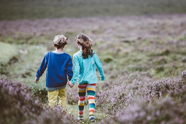 Children walking over moorland