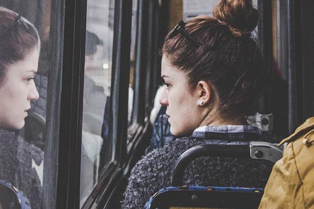 Woman staring out of the window on the bus